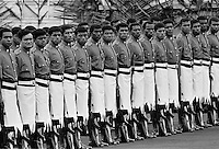 Soldiers in traditional uniforms wearing skirts in military parade in Fiji, South Pacific