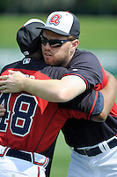 First baseman Freddie Freeman (5) of the Atlanta Braves, right, hugs former Braves star Ralph Garr prior to a Spring Training game against the New York Yankees on Wednesday, March 18, 2015, at Champion Stadium at the ESPN Wide World of Sports Complex in Lake Buena Vista, Florida. The Yankees won, 12-5. (Tom Priddy/Four Seam Images)