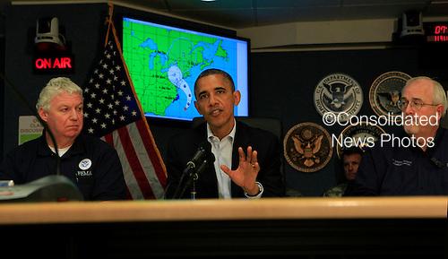 United States President Barack Obama makes a statement after a briefing on Hurricane Sandy at FEMA Headquarters in Washington, DC on Sunday, October 28, 2012.  From left to right: Richard Serino, Deputy Administrator, FEMA, President Obama, Craig Fugate, Administrator FEMA. .Credit: Dennis Brack / Pool via CNP