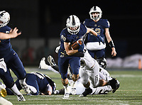 NWA Democrat-Gazette/CHARLIE KAIJO Bentonville West Nick Whitlatch (20) carries the ball, Friday, November 8, 2019 during a football game at Bentonville West High School in Centerton.