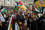 Palestinian Fatah supporters hold Palestine flags and posters of Palestinian President Mahmoud Abbas during a support rally in West Bank City of Nablus, 17 March 2014. Thousands of Palestinians in several cities in the West Bank demonstrated in support of President Mahmoud Abbas, Abbas will meet US President Barack Obama to discuss the crisis in peace talks with Israel ahead of a looming April deadline. Photo by Nedal Eshtayah