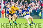 Alan Kennelly St Senans holding onto the ball closely marked by Bryan Sweeney Listowel Emmets during the North Kerry Championship game played in Mountcoal on Sunday