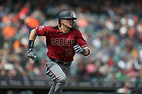 SAN FRANCISCO, CA - APRIL 11:  Nick Ahmed #13 of the Arizona Diamondbacks runs to first base against the San Francisco Giants during the game at AT&T Park on Wednesday, April 11, 2018 in San Francisco, California. (Photo by Brad Mangin)