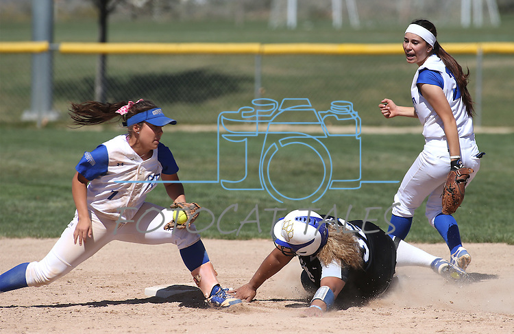 Western Nevada's Briauna Carter tries to slide around the tag of College of Southern Nevada's Jinger Meuir at Edmonds Sports Complex in Carson City, Nev., on Friday, April 1, 2016. CSN's Jessica Clifford is at right. <br />Photo by Cathleen Allison/Nevada Photo Source