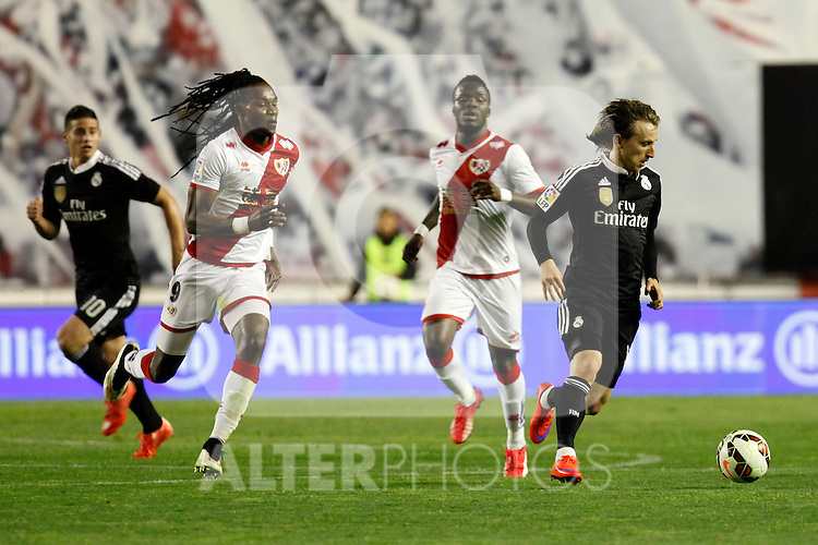 Modric of Real Madrid and Manucho of Rayo Vallecano during La Liga match between Rayo Vallecano and Real Madrid at Vallecas Stadium in Madrid, Spain. April 08, 2015. (ALTERPHOTOS/Caro Marin)