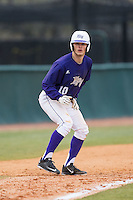 Carson Jackson (10) of the High Point Panthers takes his lead off of third base against the UNCG Spartans at Willard Stadium on February 14, 2015 in High Point, North Carolina.  The Panthers defeated the Spartans 12-2.  (Brian Westerholt/Four Seam Images)