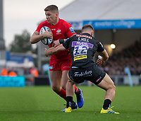 Saracens' Owen Farrell evades the tackle of Exeter Chiefs' Sam Hill<br /> <br /> Photographer Bob Bradford/CameraSport<br /> <br /> Gallagher Premiership Round 10 - Exeter Chiefs v Saracens - Saturday 22nd December 2018 - Sandy Park - Exeter<br /> <br /> World Copyright © 2018 CameraSport. All rights reserved. 43 Linden Ave. Countesthorpe. Leicester. England. LE8 5PG - Tel: +44 (0) 116 277 4147 - admin@camerasport.com - www.camerasport.com