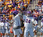 Tehoka Nanticoke (#1) celebrates a goal by Alex Burgmaster (#24) as UAlbany Lacrosse defeats Vermont 14-4  in the American East Conference Championship game at Casey Stadium, May 5.