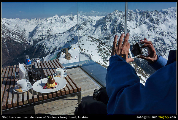 Austria, Solden.  Step Back.<br /> Step back and include a more informative and meaningful foreground. Plus, today's smart phones and mirrorless cameras tend to be biased towards a wide-angle perspective.<br /> Unlike American ski areas, European ski area restaurants offer desserts worthy of a photo.