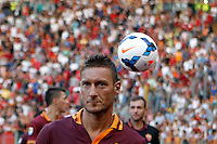"Calcio: allenamento a porte aperte ""Open Day"" per la presentazione della Roma, a Roma, stadio Olimpico, 21 agosto 2013.<br /> AS Roma forward Francesco Totti leaves at the end of the club's Open Day training session at Rome's Olympic stadium, 21 August 2013.<br /> UPDATE IMAGES PRESS/Isabella Bonotto"