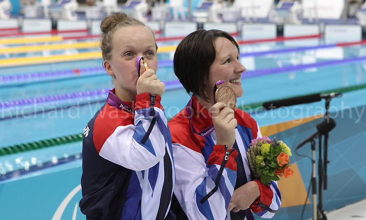 Paralympics London 2012 - ParalympicsGB - Swimming held at the Aquatic Centre 3rd September 2012  .Eleanor Simmonds and Natalie Jones face the media after they receive their medals after competing in the Women's 200m IM - SM6 Final at the Paralympic Games in London. .Photo: Richard Washbrooke/ParalympicsGB