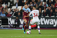 West Ham United's Jack Wilshere takes on Crystal Palace's Martin Kelly<br /> <br /> Photographer Rob Newell/CameraSport<br /> <br /> The Premier League - West Ham United v Crystal Palace - Saturday 5th October 2019 - London Stadium - London<br /> <br /> World Copyright © 2019 CameraSport. All rights reserved. 43 Linden Ave. Countesthorpe. Leicester. England. LE8 5PG - Tel: +44 (0) 116 277 4147 - admin@camerasport.com - www.camerasport.com