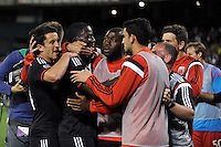 Washington D.C. - May 17, 2014: Eddie Johnson (7) of D.C. United celebrates his score with teammates.  D.C. United tied the Montreal Impact 1-1 during a Major League Soccer match for the 2014 season at RFK Stadium.