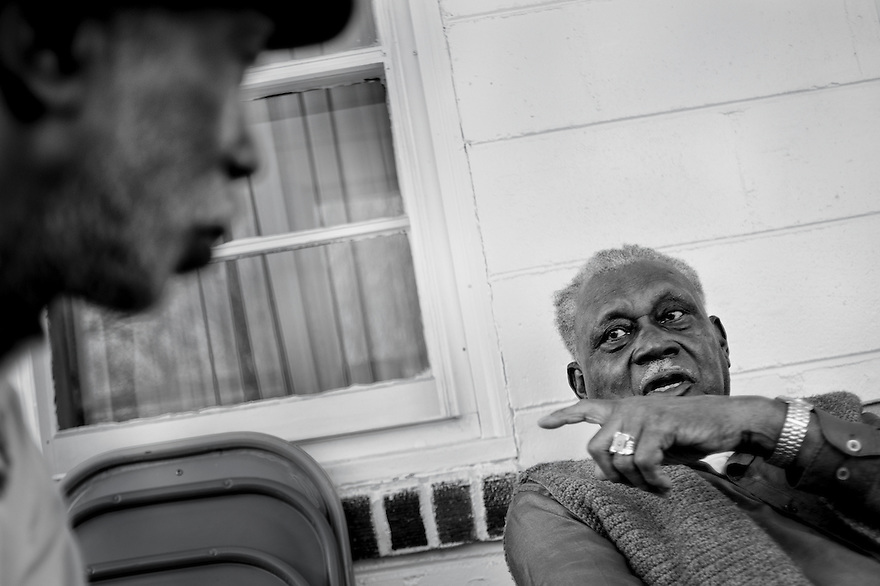 Mr. Lonnie Gailliard, 92, chats with Ernest Parks in his home in the community of Sol Legare on James Island near Charleston, SC. Gaillard is the oldest living Gullah resident in the community.