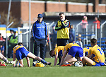 Gerry O Connor, Clare joint manager and Donal Moloney, Clare joint manager pause for thought, in the warm down  following their National League game against Waterford at Cusack Park. Photograph by John Kelly.