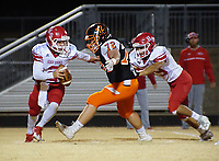 NWA DEMOCRAT-GAZETTE/RANDY MOLL<br /> Gravette senior Seth Spencer closes in for the sack against Heber Springs quarterback Adam Martin while Joseph Stacks, a Heber Springs senior, tries to push him away during a playoff game Friday, Nov. 10, 2017, at Gravette High School.
