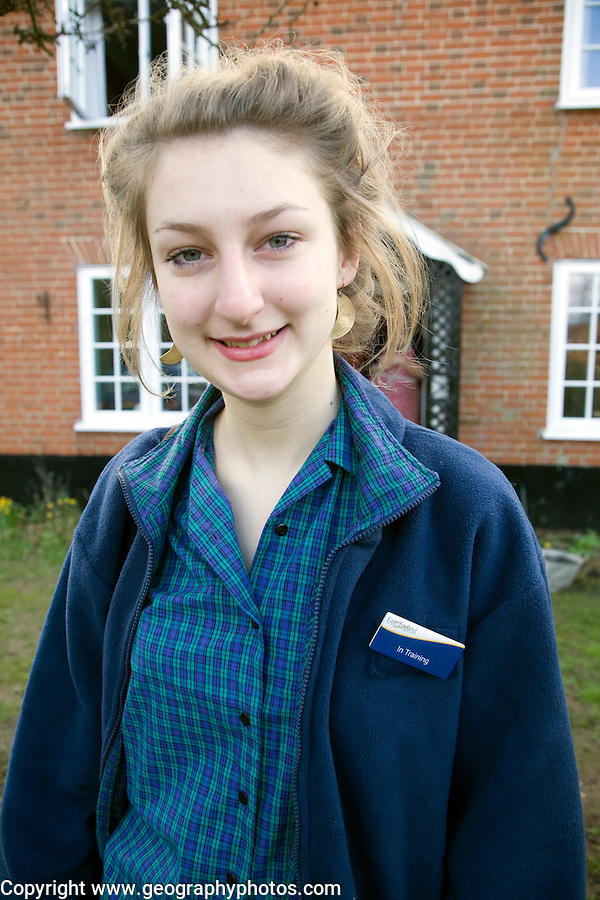Model released teenage girl in uniform for her job in a Co-operative shop, UK
