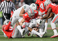 Ohio State Buckeyes defensive end Sam Hubbard (6) sacks Michigan State Spartans quarterback Brian Lewerke (14) during the second quarter of the NCAA football game at Ohio Stadium in Columbus on Nov. 11, 2017. [Adam Cairns/Dispatch]