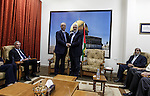Palestinian Prime Minister Rami Hamdallah shakes hands with senior Hamas leader Ismail Haniyeh, at Haniyeh's house in Gaza city on October 9, 2014. The Palestinian unity government which took the oath of office in June under technocrat prime minister Rami Hamdallah arrived to Gaza Strip on Thursday to convene the first fully meeting. Hamdallah said that the unity government will rebuild the bombed-out Gaza Strip following a seven-week Israeli offensive. Photo by Ali Jadallah