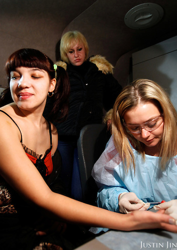 A sex worker who uses intravenous drugs tests her blood at an Outreach Program point in Chelyabinsk.