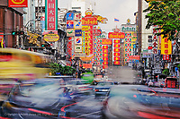 Traffic in motion flowing into Chinatown, Bangkok, Thailand
