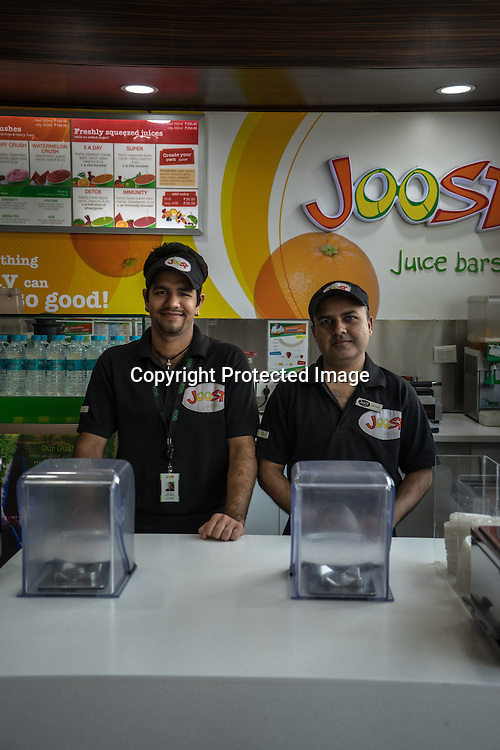 30 year old Haidar Ali (right) and Vinay Grover (24) are both deaf employees, here they pose for a portrait at Joost, a juice bar in a fitness club in New Delhi, India.