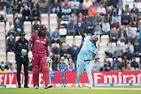 Jofra Archer (England) in action as Chris Gayle (West Indies) backs up during England vs West Indies, ICC World Cup Cricket at the Hampshire Bowl on 14th June 2019