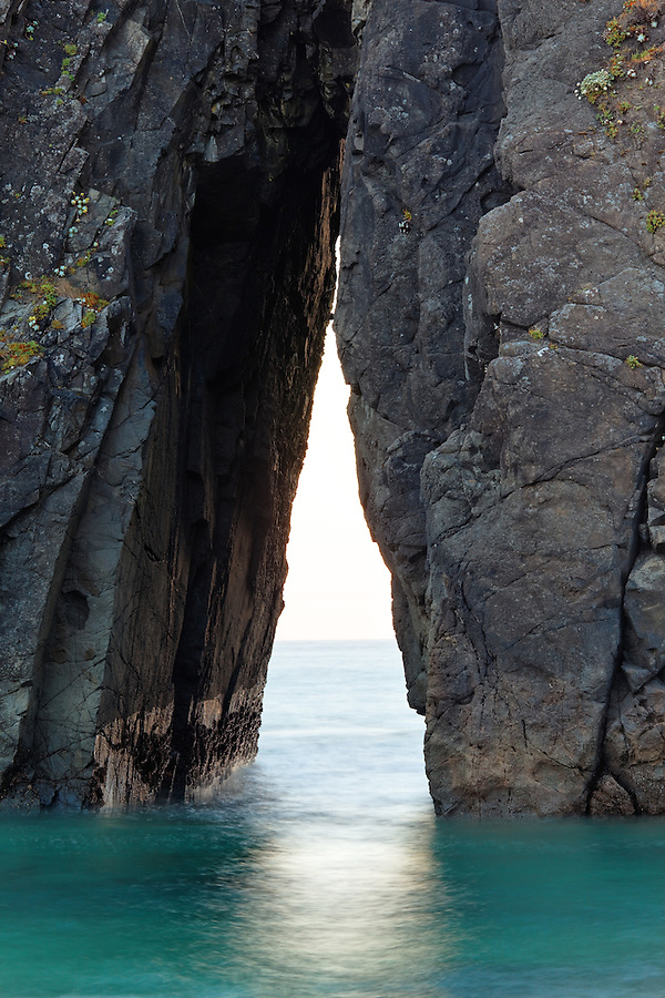 Triangular passage in sea stack, Harris Beach State Park, Brookings, Oregon, USA, North America
