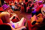 "Sex workers gather in the parlor of the Moonlite Bunny Ranch for a weekly tea party that also serves as a sort of staff meeting in Mound House, NV on Thursday, July 27, 2006...The Moonlite Bunny Ranch brothel in Mound House, Nevada - just a few miles from the state capital in Carson City - first opened in 1955. The Ranch is a legal, licensed brothel owned by Dennis Hof. It's featured in the HBO series ""Cathouse."""