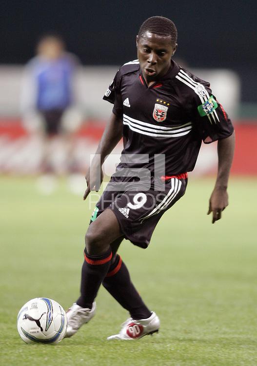 9 April 2005.  DC United forward Freddy Adu (9) holds the ball at his feet at RFK Stadium in Washington, DC.