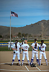 Western Nevada College Wildcats listen to the National Anthem before a college softball game at Edmonds Sports Complex in Carson City, Nev., on Friday, March 6, 2014. <br /> Photo by Cathleen Allison/Nevada Photo Source