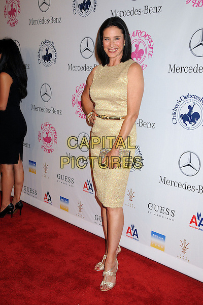 Mimi Rogers.26th Annual Carousel of Hope Gala held at the Beverly Hilton Hotel, Beverly Hills, .California, USA, 20th October 2012..full length hand on hip belt dress clutch bag shoes sandals open toe sleeveless gold smiling .CAP/ADM/BP.©Byron Purvis/AdMedia/Capital Pictures.