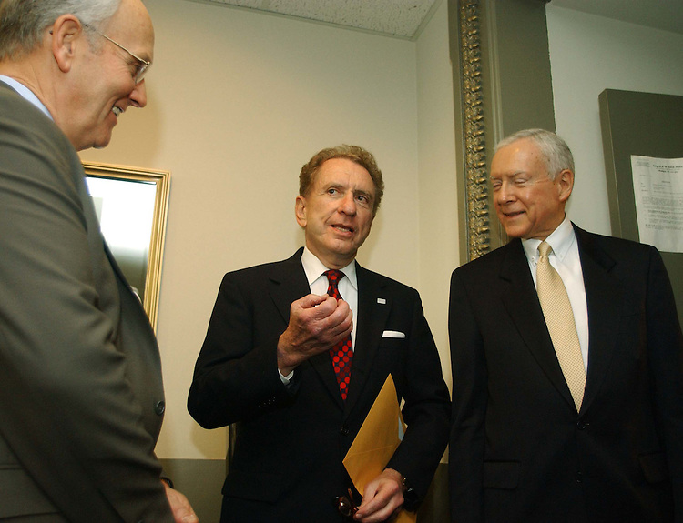 "11/18/04.SPECTER SUPPORT--Sen. Larry E. Craig, R-Idaho, Sen. Arlen Specter, R-Pa.,  and outgoing Chairman Orrin G. Hatch, R-Utah, before a news conference in which Senate Judiciary Republicans announced their unanimous support for Specter as their next chairman..From CQ.com: ""We are definitely supporting Arlen Specter for this position,"" said Orrin G. Hatch, R-Utah, who is being forced by six-year GOP term limits to relinquish the chairmanship. ""He will be the chairman of the Senate Judiciary Committee."".Social conservatives have bombarded Senate Republicans with demands that they block Specter from becoming chairman ever since he said Nov. 3 that President Bush would have a difficult time winning confirmation of any Supreme Court nominee who was eager to overturn the landmark 1973 Roe v. Wade decision legalizing abortion nationwide..Though the actual chairmanship vote will not take place until the new Congress convenes in January, Thursday's announcement appears to assure that Specter will survive the conservative onslaught. Committee Republicans have the first vote on the chairmanship, and their recommendation must then be approved by a majority of the 55 Republicans who will serve in the 109th Congress..Flanked by his fellow committee Republicans, Specter read a statement in which he said, ""I have not and would not use a litmus test to confirm nominees."".CONGRESSIONAL QUARTERLY PHOTO BY SCOTT J. FERRELL"