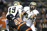 Beverly Hills, CA 09/23/11 - Andrew Jessop (Peninsula #34), Tommy Webster (Peninsula #49) and Madison Moore (Beverly Hills #49) in action during the Peninsula-Beverly Hills Varsity football game.