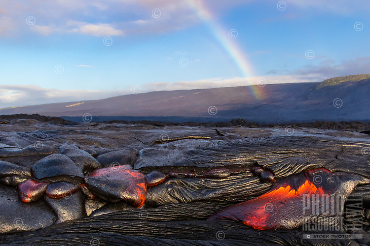 A rainbow over the lava fields of Pulama Pali, of Holei Pali, Hawai'i Volcanoes National Park, Puna district, Hawai'i Island, July 2017.