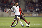 10 September 2008:  Sacha Kljestan (USA)(16) passes the ball as pressure is applied by an unidentified player for Trinidad and Tobago.  The United States Men's National Team defeated the Trinidad and Tobago Men's National Team 3-0 at Toyota Park in Bridgeview, Illinois in a CONCACAF semifinal round FIFA 2010 South Africa World Cup Qualifier.