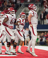 Hawgs Illustrated/Ben Goff<br /> Johnny Gibson (62), Arkansas right guard, Rakeem Boyd (5), Arkansas running back, and Cole Kelley, Arkansas quarterback, celebrate after Kelley ran in a touchdown in the 2nd quarter vs Texas A&M Saturday, Sept. 29, 2018, during the Southwest Classic at AT&T Stadium in Arlington, Texas.