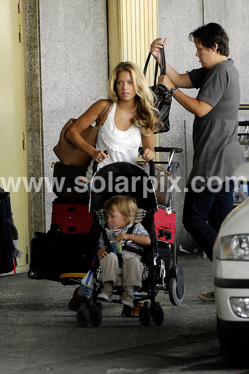 **ALL ROUND EXCLUSIVE PICTURES FROM SOLARPIX.COM**.**WORDLWIDE SYNDICATION RIGHTS EXCEPT FOR SPAIN**NO PUBLICATION IN SPAIN**.Sylvie Van de Vaart, wife of Real Madrid footballer Rafael van der Vaart, arriving at Barajas Airport, Madrid to fly back to the Netherlands with her son, Damian Rafael. 11th August 2008..JOB REF: 7001 ROL      DATE: 11_08_2008.**MUST CREDIT SOLARPIX.COM / POOL PRESS OR DOUBLE FEE WILL BE CHARGED* *UNDER NO CIRCUMSTANCES IS THIS IMAGE TO BE REPRODUCED FOR ANY ONLINE EDITION WITHOUT PRIOR PERMISSION*