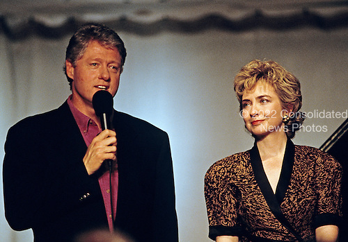 """United States President Bill Clinton makes remarks during the taping of the PBS series """"In Performance at the White House"""" on the South Lawn of the White House in Washington, D.C. on June 18, 1993. The show is to honor the 40th anniversary of the Newport Jazz Festival.  First lady Hillary Rodham Clinton looks on from the right.<br /> Credit: Ron Sachs / CNP"""