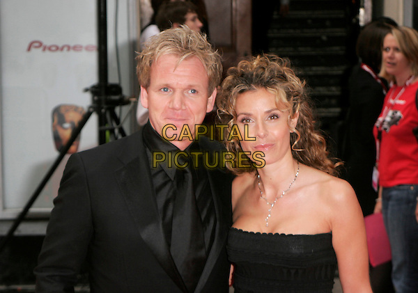 GORDON RAMSEY & TANA RAMSEY.Red Carpet Arrivals at The British Academy Television Awards (BAFTA) Sponsored by Pioneer, held at the London Palladium, London, England. .May 20th 2007.half length black suit strapless crochet husband wife married .CAP/AH.©Adam Houghton/Capital Pictures