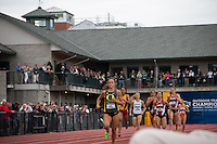 With fans looking on from the Bill Bowerman building and below, University of Oregon senior and North Dakota native Laura Roesler charges down the home-stretch, pulling away from the field on her way to victory in the 800-meter run at the 2014 NCAA Division I Outdoor Track and Field Championships in Eugene, Oregon, Friday, June 13.