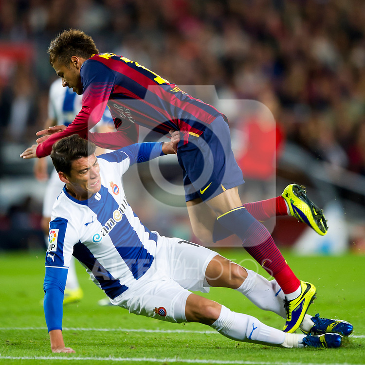 RCD Espanyol's Hector Moreno tackles FC Barcelona's Neymar Santos Jr (up) during La Liga 2013-2014 match. November 1, 2013. (ALTERPHOTOS/Alex Caparros)