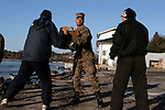 OSHIMA, Japan - A Marine with the 31st Marine Expeditionary Unit, helps Japanese locals unload a U.S. Navy landing craft here, March 27. The 31st Marine Expeditionary Unit delivered food, water, health and comfort supplies, and Japanese electrical utility vehicles to the isolated island of Oshima, in conjunction with Japanese Self-Defense Forces. The 31st involvement is part of a larger U.S. government response, after a 9.0 earthquake and subsequent tsunami struck Japan causing widespread damage. The 31st MEU is ready to support our Japanese partners and to provide assistance when called upon. (Photo by USMC/AFLO) [0006]