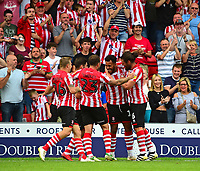 Lincoln City's Matt Green celebrates scoring his sides fourth goal with team mates<br /> <br /> Photographer Andrew Vaughan/CameraSport<br /> <br /> The EFL Sky Bet League Two - Lincoln City v Swindon Town - Saturday August 11th 2018 - Sincil Bank - Lincoln<br /> <br /> World Copyright &copy; 2018 CameraSport. All rights reserved. 43 Linden Ave. Countesthorpe. Leicester. England. LE8 5PG - Tel: +44 (0) 116 277 4147 - admin@camerasport.com - www.camerasport.com