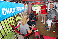 NWA Democrat-Gazette/DAVID GOTTSCHALK Bobbie Bratton (from left), David Carnevale, Kyle Crafton and Kendall Apple visit Friday, June 7, 2019, outside of Baum-Walker Stadium, the home venue of the Arkansas Razorbacks baseball team, in Fayetteville. The group spent Thursday night and planned on spending Friday night in an effort to be the first to enter the Hog Pen outfield area of the stadium for the Razorbacks' NCAA super regional against Ole Miss at 11 a.m. today.
