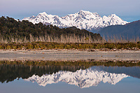 Aoraki Mount Cook 3724m and Mount Tasman 3497m of Southern Alps reflecting in Cook River lagoon near Fox Glacier on winter twilight, Westland Tai Poutini National Park, West Coast, UNESCO World Heritage Area, New Zealand, NZ