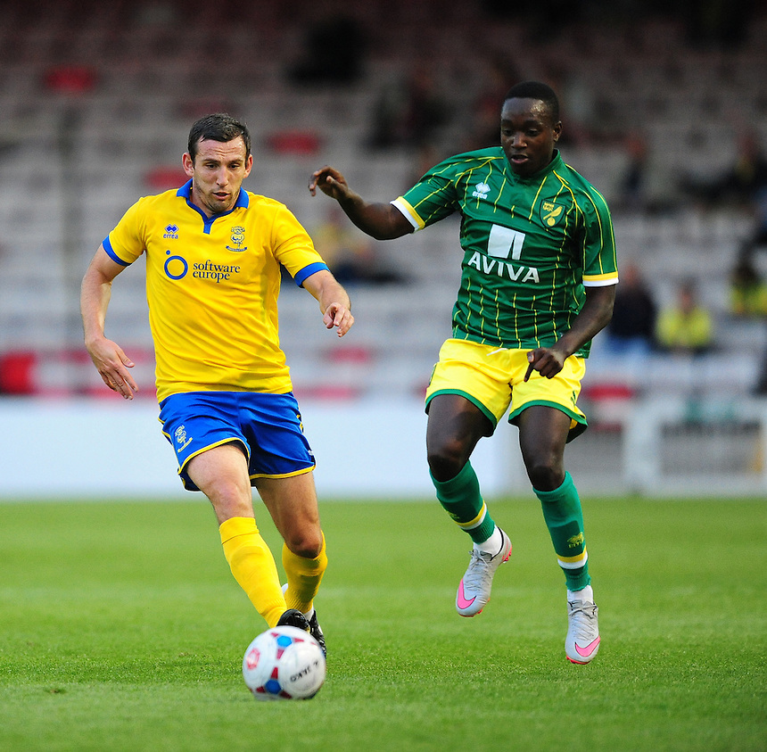 Lincoln City&rsquo;s Craig Stanley vies for possession with Norwich City&rsquo;s Jamar Loza<br /> <br /> Photographer Chris Vaughan/CameraSport<br /> <br /> Football - Football Friendly - Lincoln City v Norwich City - Wednesday 29th July 2015 - Sincil Bank - Lincoln<br /> <br /> &copy; CameraSport - 43 Linden Ave. Countesthorpe. Leicester. England. LE8 5PG - Tel: +44 (0) 116 277 4147 - admin@camerasport.com - www.camerasport.com