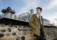 Fashion<br /> England, South East, Brighton<br /> Joe Thorpe models the Pretty Green Parka Jacket outside Brighton Pier. Pretty Green is a fashion label formed and designed by Liam Gallagher singer from Oasis and now Beady Eye.<br /> Pretty Green Jacket: &pound;189.95. 02/01/2014. Tobias Holbeche