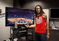 Jun. 10, 2013; Phoenix, AZ, USA: Phoenix Mercury center Brittney Griner shows off her score in NBA 2K13 on an Xbox in the teams locker room at the US Airways Center. Mandatory Credit: Mark J. Rebilas-