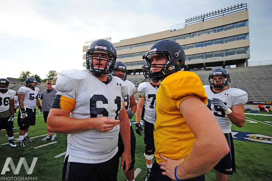 Aug 15, 2012; Toledo, OH, USA; Toledo Rockets offensive lineman Erik Carlson (61) and quarterback Austin Dantin huddle prior to a play during practice at the Glass Bowl. Mandatory Credit: Andrew Weber-US Presswire